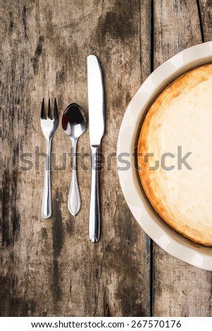 Fresh baked cheesecake on wooden table. Eco food background. Top view image - stock photo