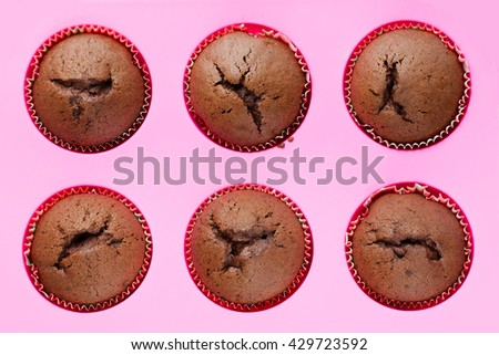 Fresh baked chocolate muffins top view - stock photo