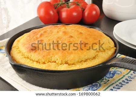 Fresh baked cornbread cooling near the window - stock photo