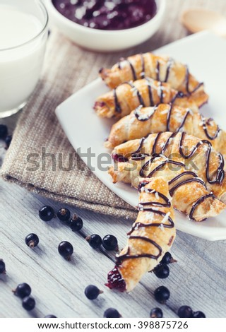 Fresh baked croissants with berry and milk