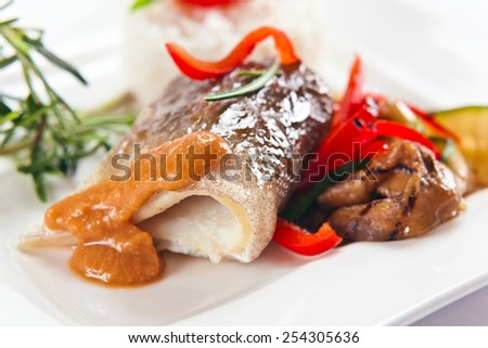 fresh baked fish on a white plate