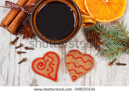 Fresh baked homemade decorated gingerbread and Christmas cookies, cup of coffee and spices on old white wooden background, christmas time - stock photo