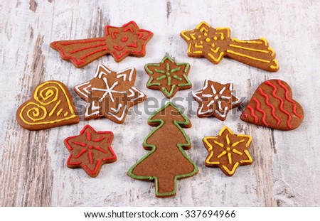 Fresh baked homemade decorated gingerbread, Christmas cookies on old white wooden background, christmas time