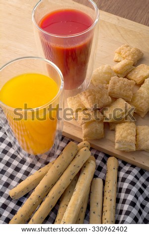 Fresh baked homemade grissini bread sticks and  crispy pie with egg and juice