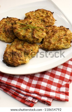 Fresh baked potato pancakes in white plate - stock photo