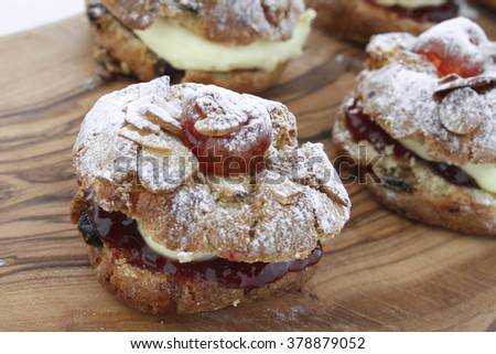 fresh baked scone caked filled with cream and jam