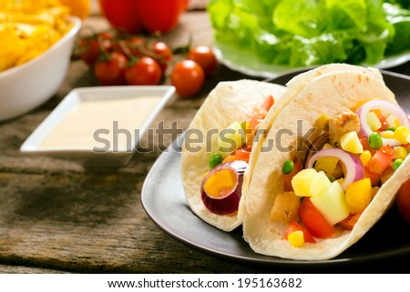 Fresh baked tortilla with vegetables and meat.Selective focus on the front tortilla - stock photo