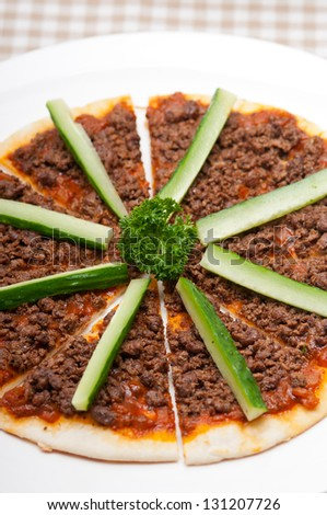 fresh baked Turkish beef pizza with cucumber on top - stock photo