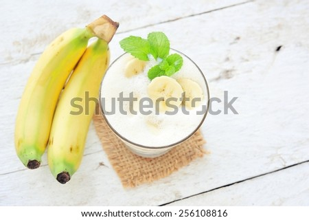 Fresh banana smoothies with milk. - stock photo