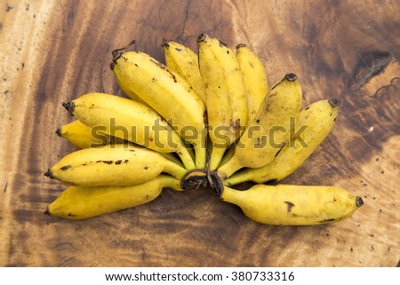 Fresh bananas on wooden background - stock photo