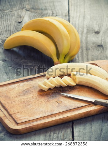 Fresh bananas on wooden background.Selective focus - stock photo