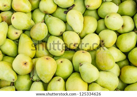 Fresh Bartlett pears on display at the farmer's market - stock photo