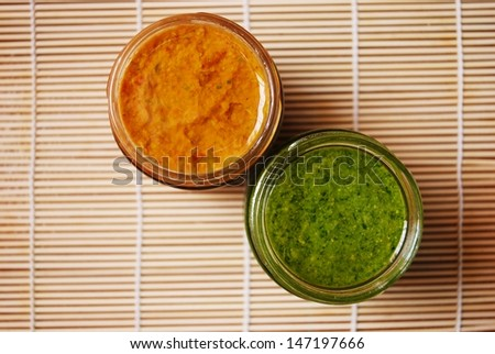 Fresh basil pesto and tomatoes sauce, typical italian dressing for pasta