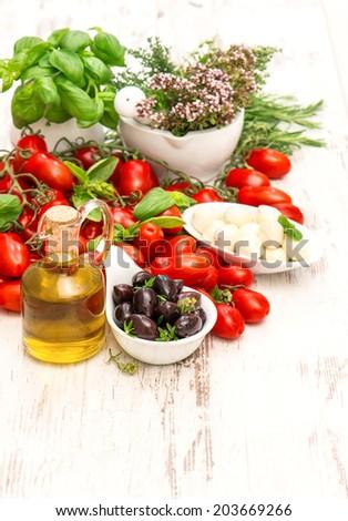 fresh basil, tomatoes, mozzarella and olive oil. food background. caprese salad ingredients - stock photo