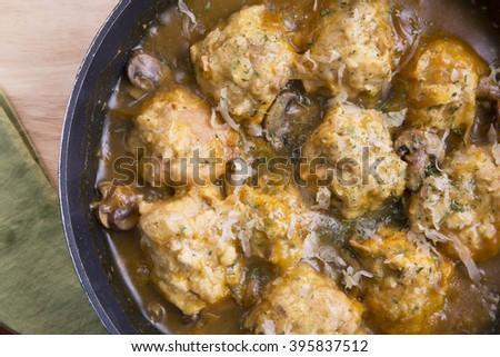 Fresh Bavarian bread dumplings with mushroom gravy sauce. - stock photo