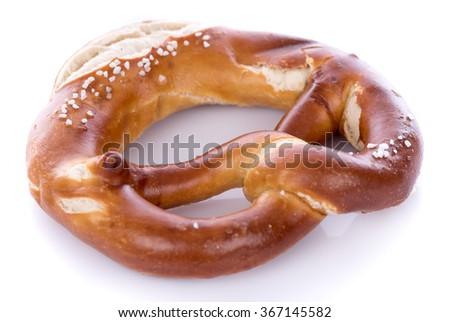 Fresh bavarian pretzel, isolated on white - stock photo