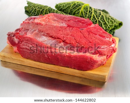 Fresh beef meat on cutting board - stock photo