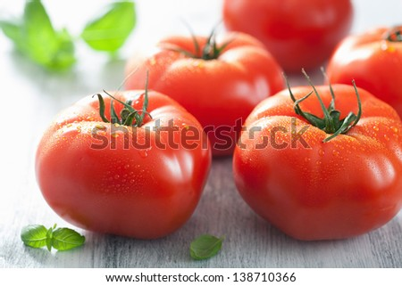 fresh beef tomatoes and basil leaves - stock photo