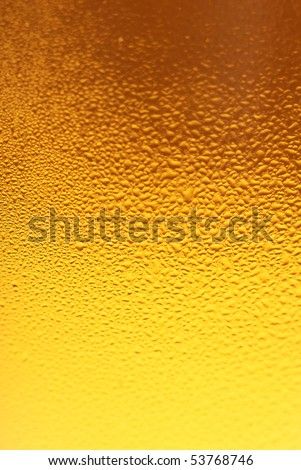 Fresh beer dewy glass texture close-up - stock photo