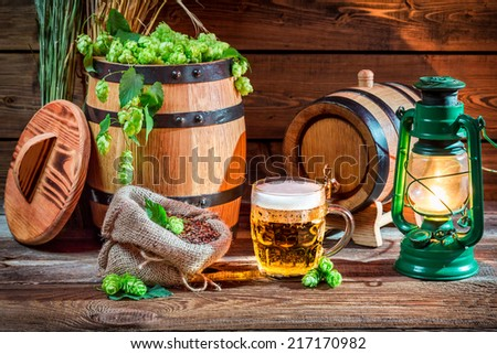 Fresh beer straight from the barrel - stock photo