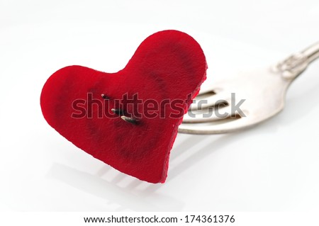 Fresh beetroot in shape of heart - stock photo