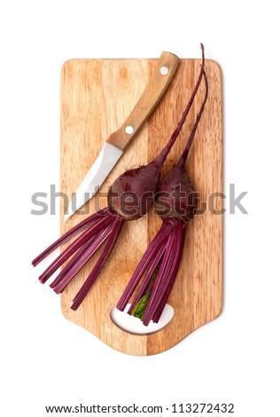 fresh beetroot on cutting board - stock photo