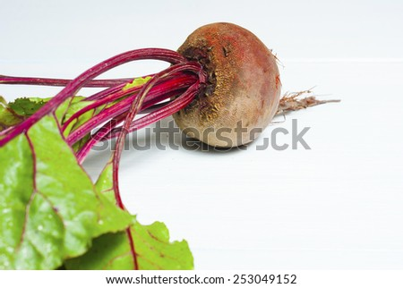 fresh beetroot with leaves on white wooden - stock photo