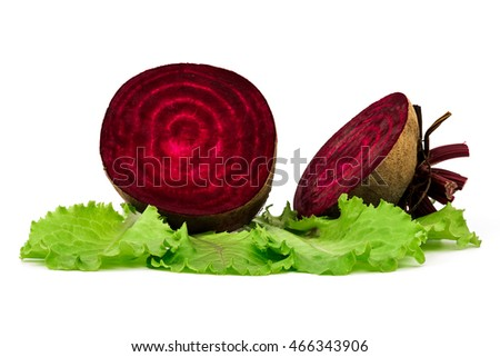 Fresh beets on green salad leaves isolated on white background.