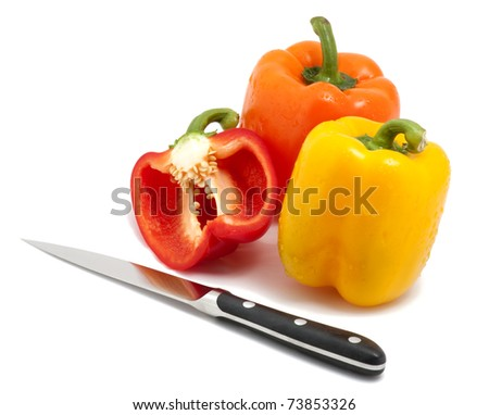 Fresh bell peppers and knife