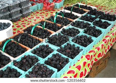 Fresh berries at a farmer's market - stock photo