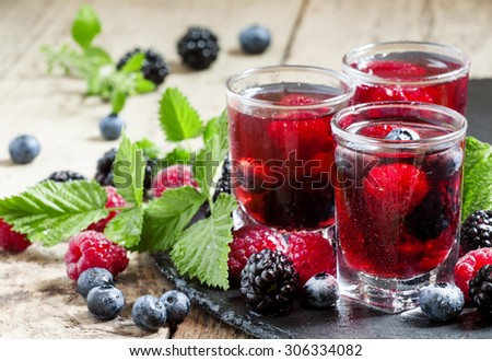 Fresh berry drink with blueberries, blackberries and raspberries, selective focus - stock photo