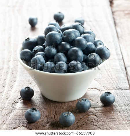fresh bilberries in a bowl - stock photo