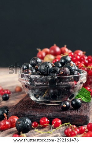 fresh black currant on a wooden table. At eye level - stock photo