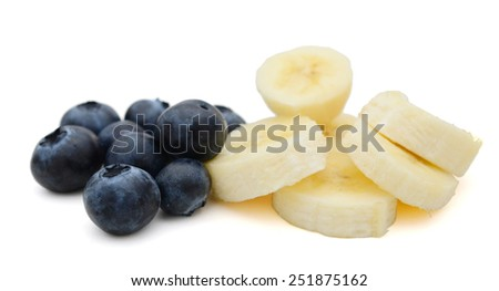 fresh blueberries and banana slices on white background - stock photo