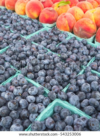 Fresh blueberries and peaches at farmers market.