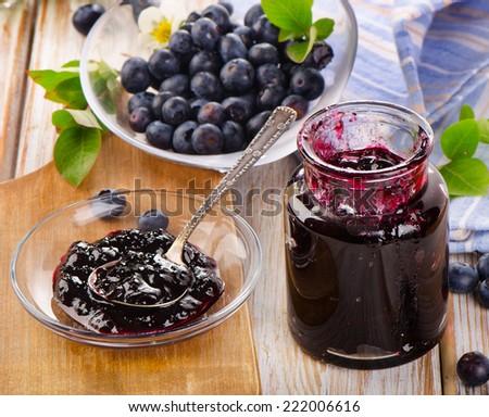 Fresh blueberries jam  in  glass jar. Selective focus  - stock photo