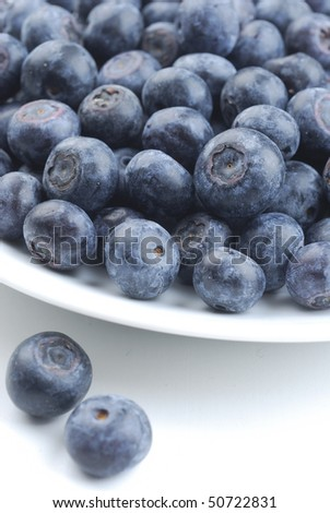 Fresh blueberries on white dish