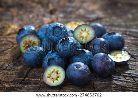 Fresh blueberries on wooden background - stock photo