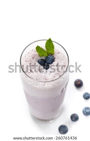 Fresh Blueberry Smoothie on white background. Selective focus. - stock photo