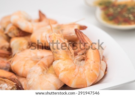 Fresh boiled or steamed shrimps with chili fish sauce for seafood background - stock photo