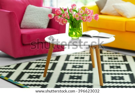 Fresh bouquet of tulips on a coffee table - stock photo