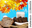 fresh bread and food for healthy breakfast on the background of autumn leaves - stock photo