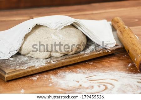 Fresh bread dough ready for baking - stock photo