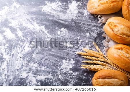 fresh bread on dark background, top view - stock photo