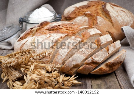 Fresh bread on wooden ground - stock photo