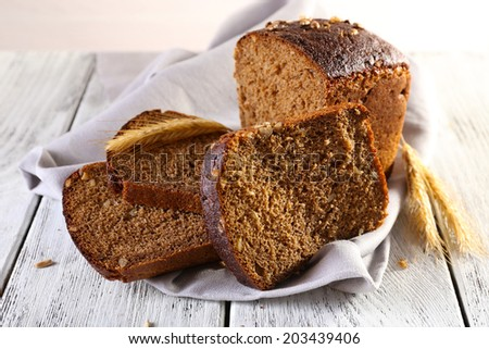 Fresh bread on wooden table, close up - stock photo