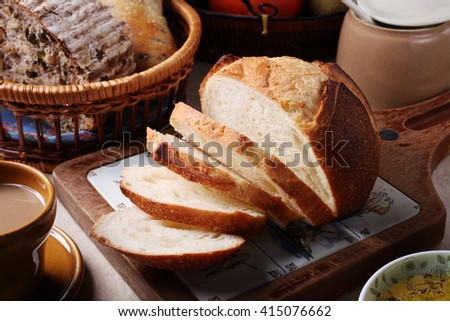 Fresh bread slice on cutting board          - stock photo