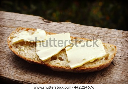 fresh bread with butter - stock photo