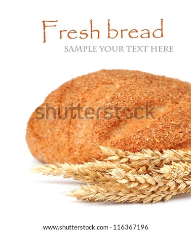 Fresh bread with wheat on white background