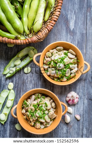 Fresh broad beans served with parsley and garlic - stock photo